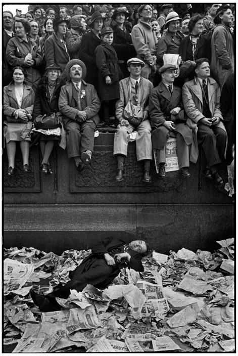 "GREAT BRITAIN. London. Coronation of King George VI. 12 May 1937. ""People had waited all night in Trafalgar Square in order not to miss any part of the coronation ceremony of George VI. Some slept on benches and others on newspapers. The next morning, one who was wearier than the others, had not yet wakened to see the ceremony for which he had kept such a late vigil."""